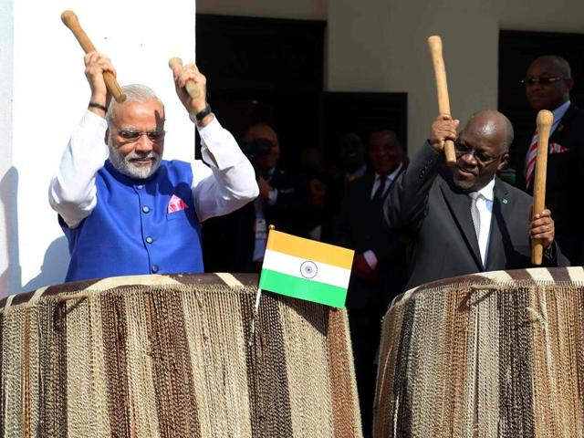Prime Minister Narendra Modi (L) and Tanzania's President John Magufuli play drums at State House in Dar es Salaam on July 10.