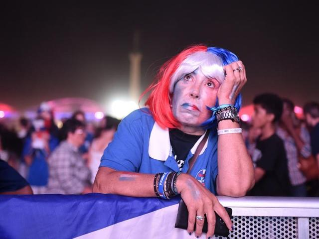 French supporter poses near the Paris fan zone before the start of the Portugal v France.