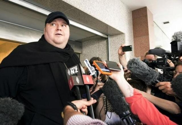 German tech entrepreneur Kim Dotcom speaks to the press after appearing in an Auckland courthouse, New Zealand.