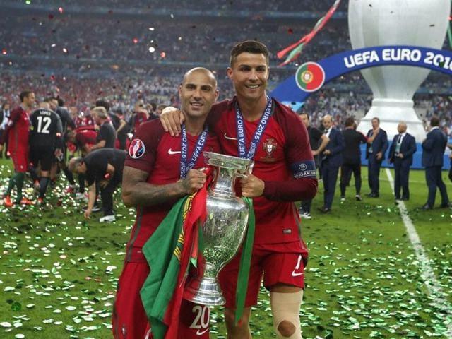 Portugal's forward Ricardo Quaresma hugs Portugal's forward Cristiano Ronaldo after their team's win.