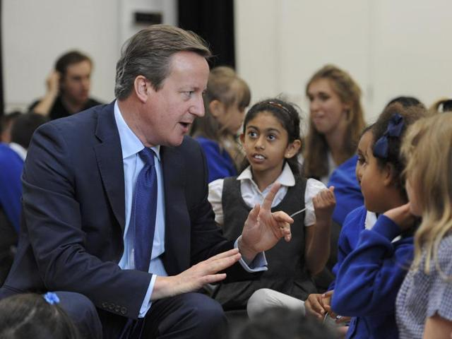 British Prime Minister David Cameron is seen during a visit to Reach Academy Feltham in southwest London on Tuesday. Cameron chaired his final cabinet meeting on Tuesday after six years as Britain's premier.