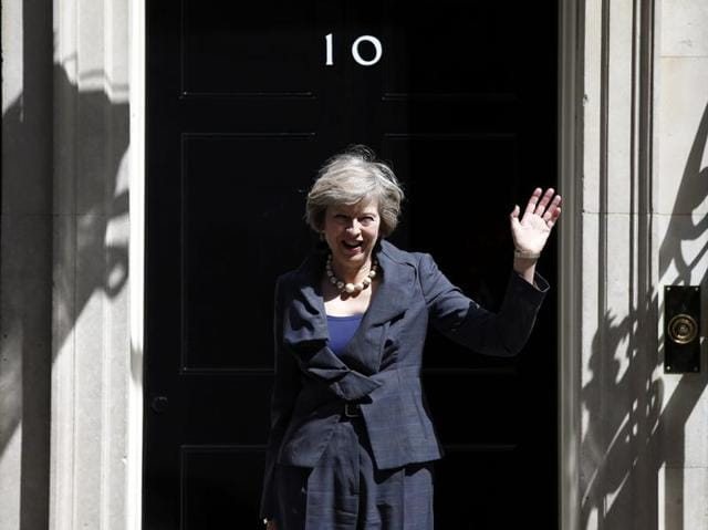 Britain's home secretary Theresa May leaves after attending a cabinet meeting at 10 Downing Street, in London on Tuesday. May will become Britain's new prime minister on Wednesday.