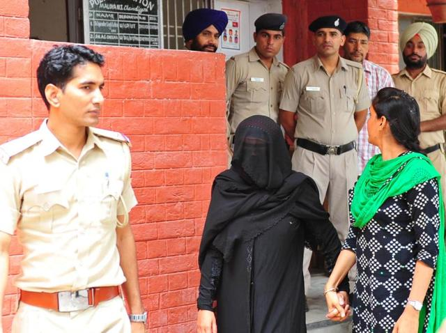 The accused woman (In black dress) in police custody at Maloya Police station, Chandigarh on Monday.