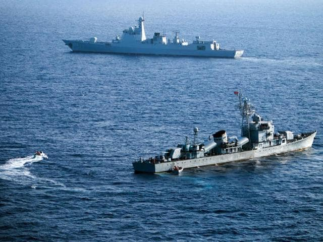 """This file photo shows crew members of China's South Sea Fleet taking part in a drill in the Xisha Islands, or the Paracel Islands in the South China Sea.  A UN-backed international tribunal ruled  that China has no legal basis to claim """"historic rights"""" to islands in the South China Sea."""