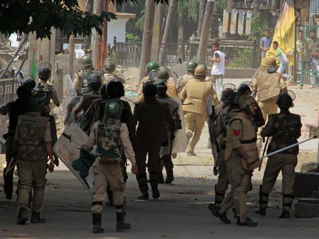 CRPF personnel face-off with protesters throwing stones at them in Srinagar. The killing of a militant leader has sparked clashes between protesters and security forces in which 30 people have died.