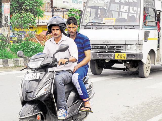 Uttarakhand news,helmet rule,helmet for pillion riders