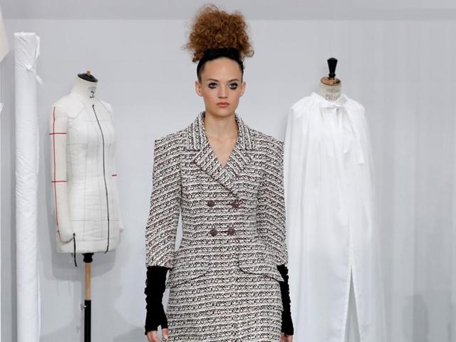 A model presents a cocktail dress by German designer Karl Lagerfeld as part of his Haute Couture Fashion Week.
