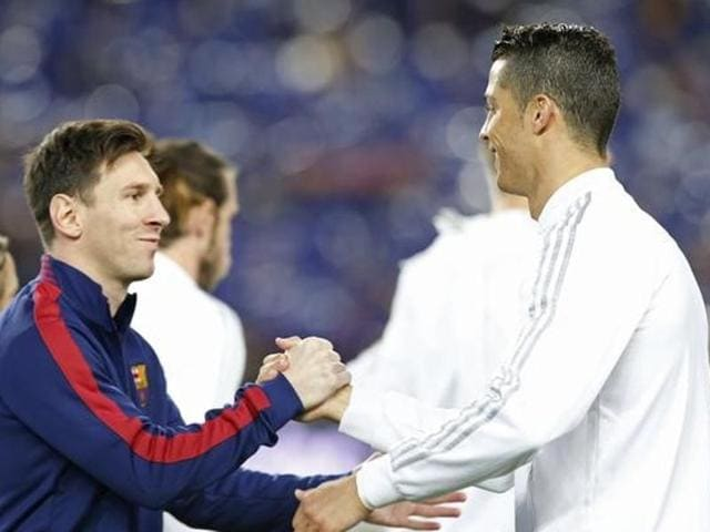 Barcelona's Lionel Messi shakes hands with Real Madrid's Cristiano Ronaldo before the game.