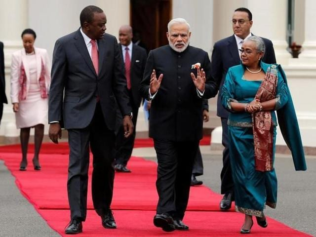 Narendra Modi walks with Kenyan President Uhuru Kenyatta and First Lady Margaret during the official welcoming ceremony at the State House in Nairobi,