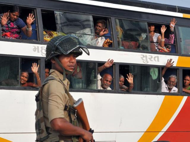 Security forces stand guard at Jammu & Kashmir national highway.