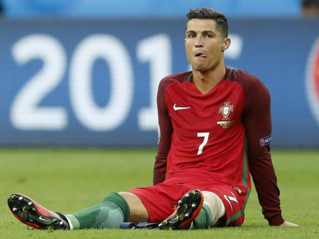 Portugal's Cristiano Ronaldo reacts after sustaining an injury.