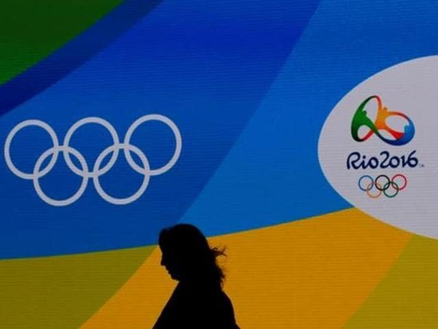 Flags with the logo of Rio 2016 Olympic and Paralympic Games among others reading