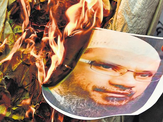 An effigy of Zakir Naik was burnt by members of the Bharatiya Janata Party's minority cell on Tuesday.