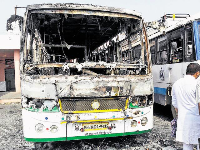 A bus burnt at the Malerkotla bus stand after the sacrilege.