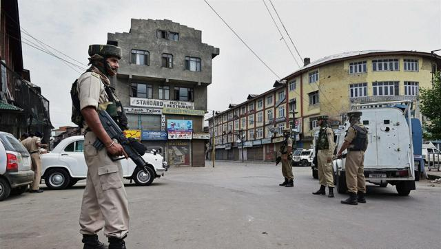 Security forces stand vigil while restrictions were imposed in the aftermath of violence in Srinagar.