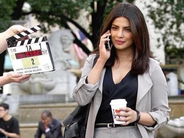 Priyanka is dressed in grey trousers teamed same-coloured long jacket for the first day of the shoot.