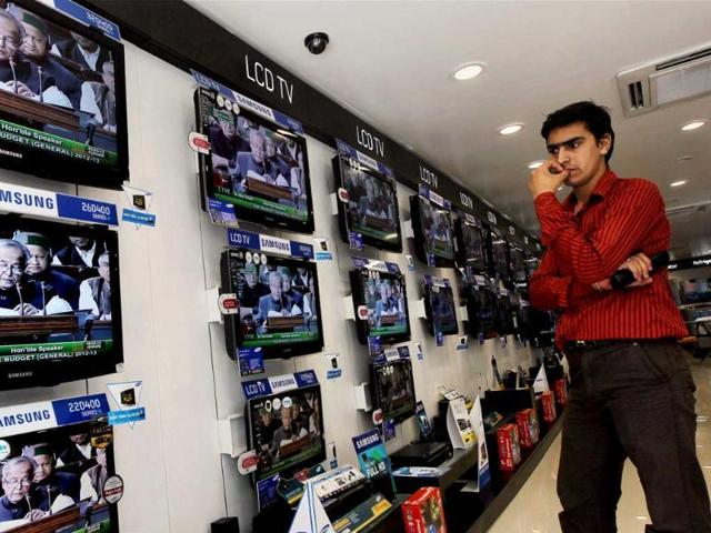 A man watches news on TV at an electronics showroom in Chennai. The information and broadcasting ministry has no data on how many banned channels are being downloaded and aired illegally in the country.