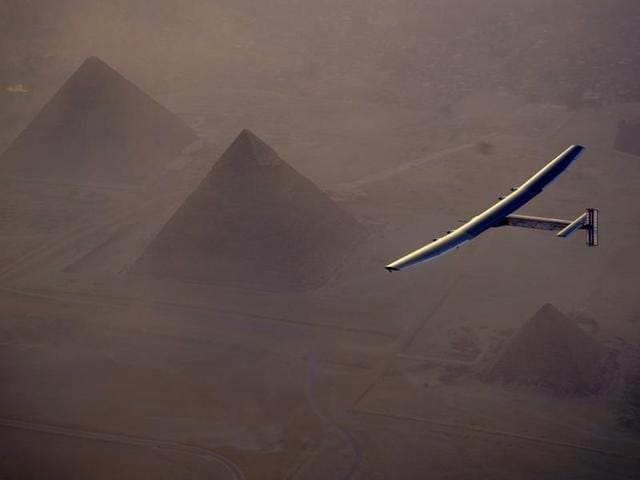 In this Wednesday, July 13, 2016, handout image provided by Solar Impulse, the Solar Impulse 2 flying over the pyramids, Egypt Cairo.