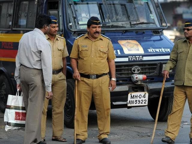 Policemen in Mumbai stand guard at a marketplace. India's cops are called names, each region has its own.(Arijit Sen / HT Photo)
