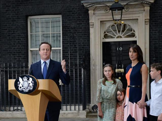 Outgoing British prime minister David Cameron speaks beside (L-R) his family outside 10 Downing Street in central London on July 13, 2016 before going to Buckingham Palace to tender his resignation to Queen Elizabeth II.