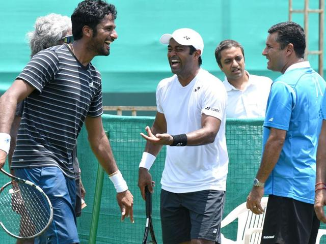 While Rohan Bopanna (right) and Leander Paes seemed to be gelling on court during practice on Wednesday.