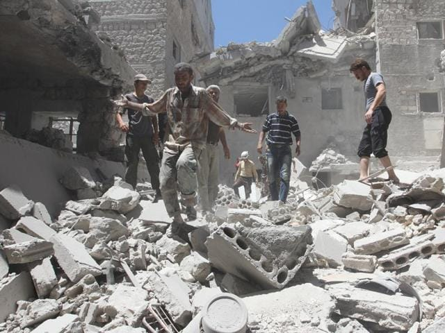 A man reacts at a site hit by airstrikes in the rebel-controlled town of Ariha in Idlib province, Syria.