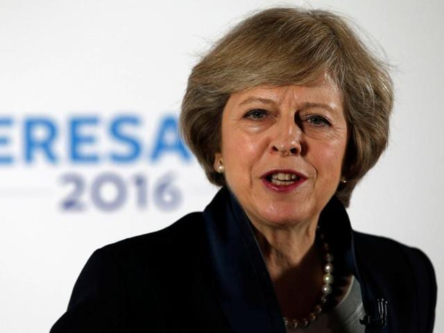 Britain's home secretary and new leader of the Conservative Party Theresa May arrives at 10 Downing Street in London on Tuesday, as she prepares to attend Prime Minister David Cameron's last cabinet meeting.