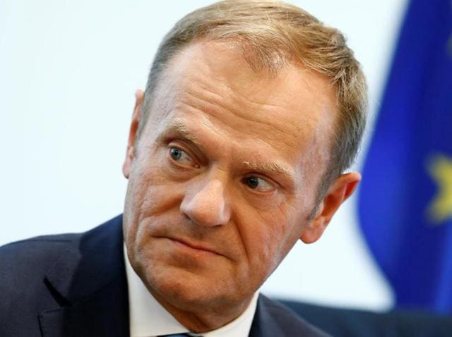 European Council president Donald Tusk attends a news conference at the Delegation of the European Union to China in Beijing.