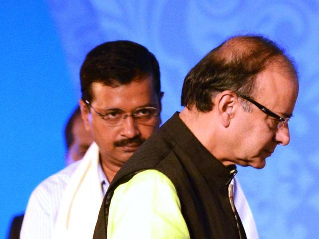 Union finance minister Arun Jaitley walks past Delhi chief minister Arvind Kejriwal during the start of the Bengal Global Business Summit 2016 in Kolkata.