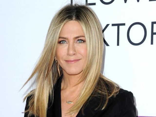 Aniston says she's not pregnant and she's fed up with predatory tabloid culture that defines women by their looks and maternal status.