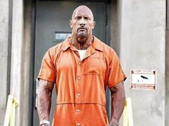 Dwayne Johnson, 44, reveals a shot from Fast and Furious 8 where he is seen in chained cuffs and a prison's orange colour jumpsuit. (Instagram)