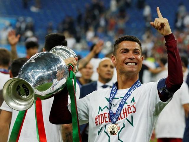Portugal's Cristiano Ronaldo celebrates with the trophy after winning Euro 2016.