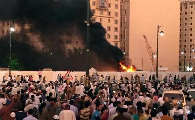 Muslim worshippers gather after a suicide bomber detonated a device near the security headquarters of the Prophet's Mosque in Medina, Saudi Arabia on July 4.