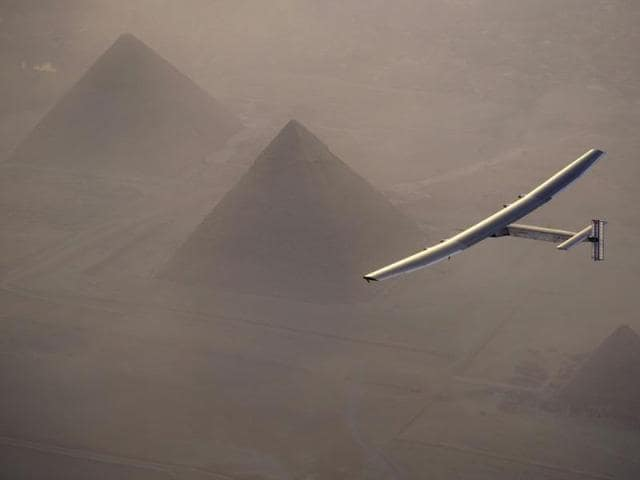 Solar Impulse 2, a solar powered plane piloted by Swiss aviator Andre Borschberg, is seen as it prepares to land at Cairo Airport, Egypt on Wednesday.