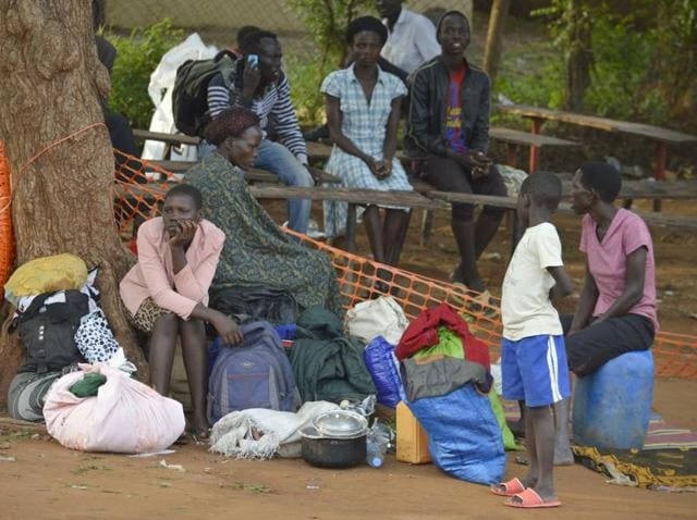 People take shelter near the All Saints Church in Juba, South Sudan. Embassies and aid organisations in South Sudan were trying to evacuate staff from the capital, Juba, on Tuesday as a precarious calm settled over the city following several days of deadly clashes.