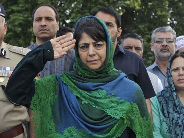 Jammu and Kashmir chief minister Mehbooba Mufti salutes a police guard of honour at the Mazar-e-Shohda (Martyr's Graveyard), during the commemoration of Martyrs' Day in Srinagar on Wednesday.