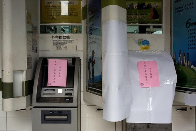 Combining cybercrime with daylight robbery after a typhoon battered greater Taipei, the suspects may have used a cellphone to trigger 41 First Bank ATMs to dispense fat wads of bills