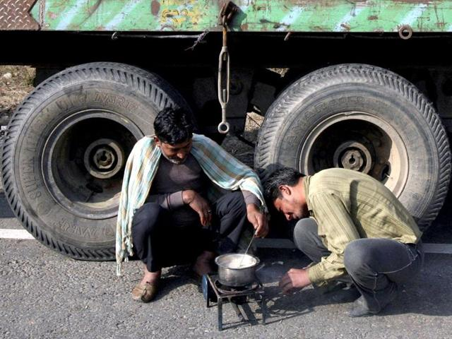Stranded drivers prepare tea on a kerosene stove in front of a supply truck on the Jammu Srinagar national highway on the outskirts of Jammu.