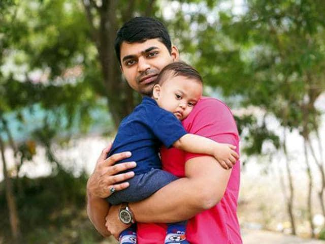 Aditya Tiwari with his son.