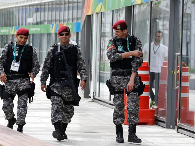 Brazilian Public-Safety National Force personnel patrol at the 2016 Rio Olympics Park in Rio de Janeiro.
