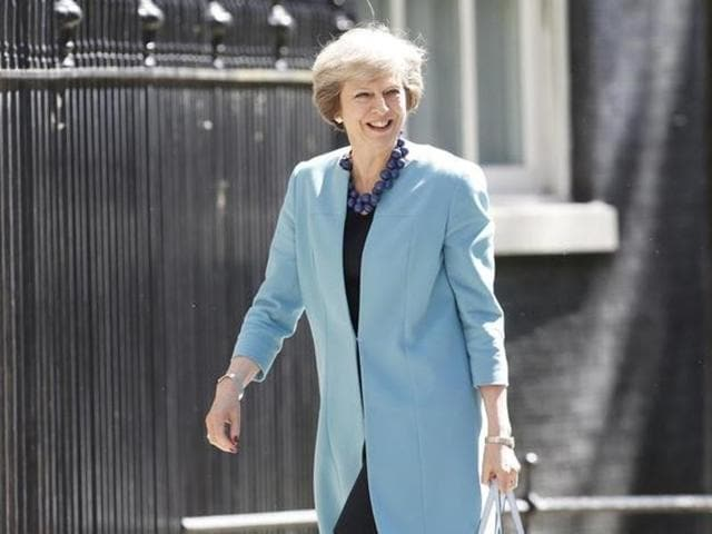 Britain's Prime Minister Theresa May arrives in Downing Street, London, on Thursday. May is filling more cabinet posts as she assembles a government that includes prominent anti-EU figures in key roles.