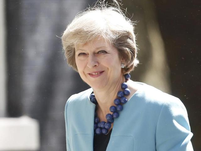 Britain's Prime Minister Theresa May arrives at 10 Downing Street, in central London.