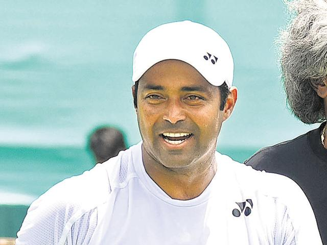 Leander Paes and Anand Amritraj (in black) during a practice session ahead of the India-South Korea Davis Cup tie at the Chandigarh Club on Wednesday.
