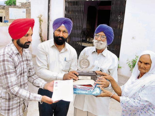 Naik Sarup Singh (second from right) being honoured at his house near Pinjore on Wednesday.