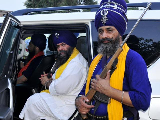 Flanked by private guards, Budha Dal head Balbir Singh in his bullet-proof car.