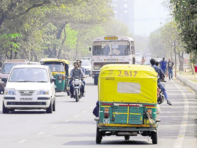 In the absence of proper walkways, pedestrians end up walking on busy roads amidst traffic.