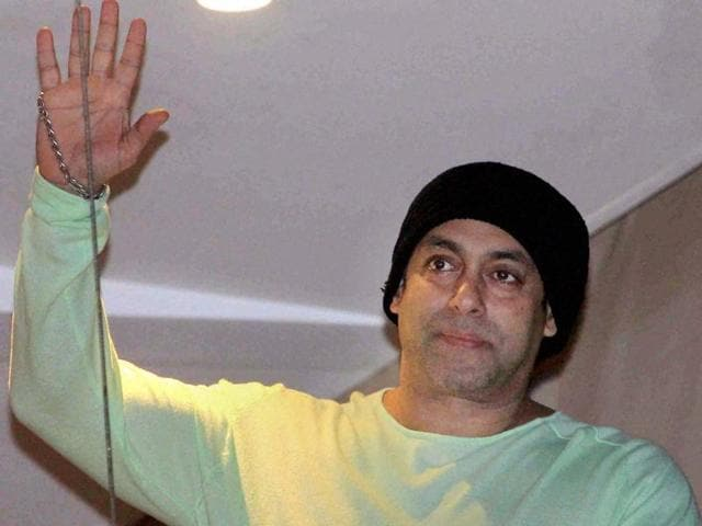 Bollywood actor Salman Khan waves to his fans during Eid al-Fitr celebrations in Mumbai.