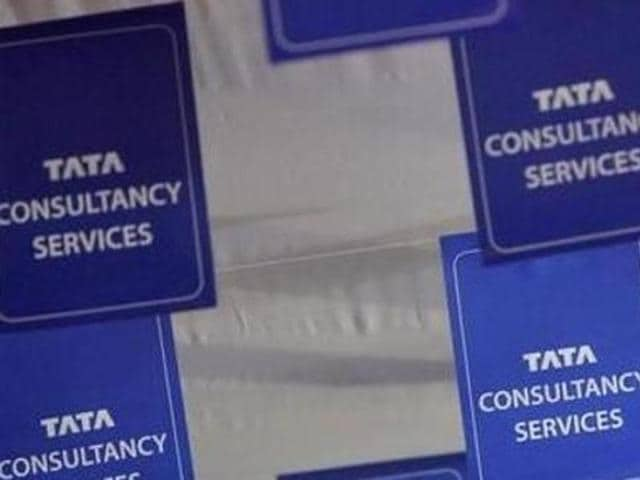 Logos of Tata Consultancy Services (TCS) are displayed at the venue of the annual general meeting in Mumbai , a few years back.