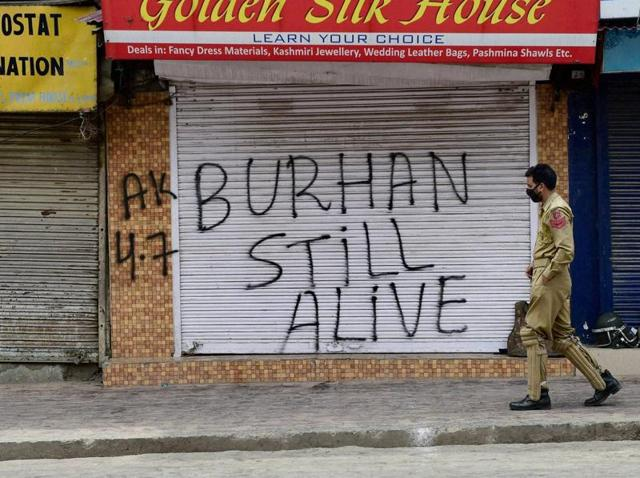 Policemen patrol a deserted Srinagar owing to curfew through the Kashmir Valley. The death of Hizbul Mujahideen commander, Burhan Wani, has caused much unrest in the Valley, with 37 people dying from injuries sustained during protests.