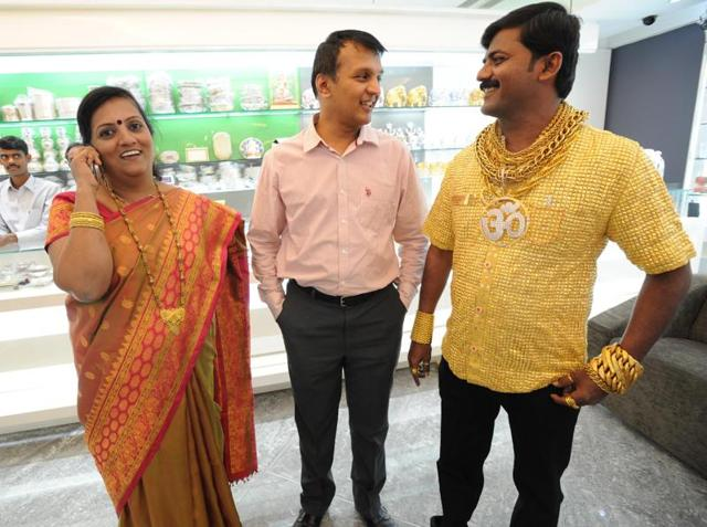 Datta Phuge (right), husband of NCP corporator from Pimpri-Chinchwad Seema Phuge (left), in his gold shirt.